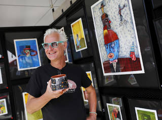 "Oklahoma City artist Mike ""Kemper""with some of the colorful art displayed in his tent at at the 2014 Festival of the Arts in downtown Oklahoma City l on Wednesday. Photo by Jim Beckel, The Oklahoman Jim Beckel - THE OKLAHOMAN"