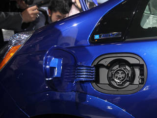 The charging port on the new all-electric 2013 Honda Fit EV is seen Nov. 16 during its debut at the Los Angeles Auto Show. AP Photo