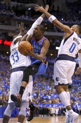 Oklahoma City's Kevin Durant (35) goes to the basket between Dallas' Brendan Haywood (33) and Shawn Marion (0) during Game 3 of the first round in the NBA playoffs between the Oklahoma City Thunder and the Dallas Mavericks at American Airlines Center in Dallas, Thursday, May 3, 2012. Photo by Bryan Terry, The Oklahoman