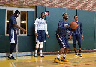 Indiana Pacers basketball players, from left, Solomon Hill, Lavoy Allen, C.J. Watson and George Hill wear Google glasses during practice at Bankers Life Fieldhouse in Indianapolis. AP File Photos Celeste ballou - AP