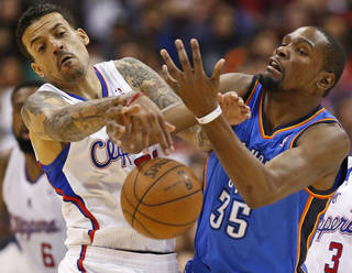 Oklahoma City's Kevin Durant (35) has the ball knocked away by Los Angeles' Matt Barnes (22) during Game 4 of the Western Conference semifinals in the NBA playoffs between the Oklahoma City Thunder and the Los Angeles Clippers at the Staples Center in Los Angeles, Sunday, May 11, 2014. Photo by Nate Billings, The Oklahoman