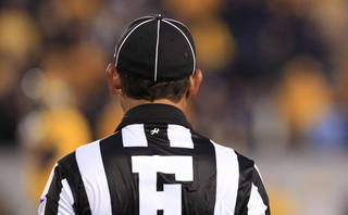 A college football official. (AP Photo/Christopher Jackson)