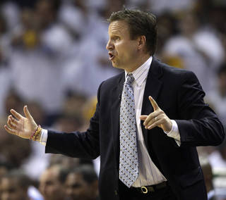Oklahoma City Thunder coach Scott Brooks directs his players during the first half of Game 4 against the Memphis Grizzlies in a second-round NBA basketball playoff series on Monday, May 9, 2011, in Memphis, Tenn. (AP Photo/Wade Payne)
