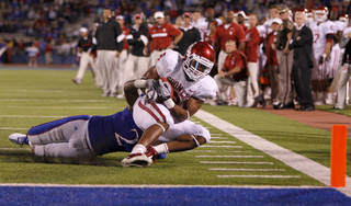 Oklahoma's Dominique Whaley (8) is brought down short of the goal by Kansas' Darius Willis (2) during the college football game between the University of Oklahoma Sooners (OU) and the University of Kansas Jayhawks (KU) at Memorial Stadium in Lawrence, Kansas, Saturday, Oct. 15, 2011. Photo by Bryan Terry, The Oklahoman