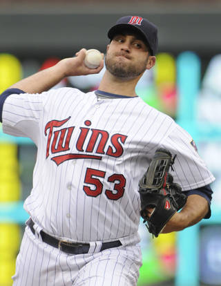 Minnesota Twins pitcher Nick Blackburn throws against the Tampa Bay Rays in the first inning of a baseball game Saturday, Aug. 11, 2012 in Minneapolis. (AP Photo/Jim Mone)