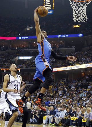 Oklahoma City's Russell Westbrook (0) dunks the ball in front of Memphis' Tayshaun Prince (21) during Game 4 in the first round of the NBA playoffs between the Oklahoma City Thunder and the Memphis Grizzlies at FedExForum in Memphis, Tenn., Saturday, April 26, 2014. Photo by Bryan Terry, The Oklahoman