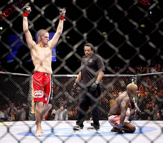 Nate Diaz, left, celebrates after forcing a submission of Melvin Guillard during UFC Fight Night. Photo by Bryan Terry, The Oklahoman