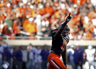 Oklahoma State's Shaun Lewis (11) celebrates an interception during the second half of a college football game between the Oklahoma State University Cowboys (OSU) and the Kansas State University Wildcats (KSU) at Boone Pickens Stadium in Stillwater, Okla., Saturday, Oct. 5, 2013. OSU won 33-29.Photo by Sarah Phipps, The Oklahoman