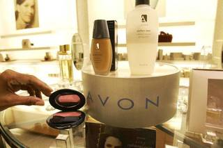 Items are placed on display in an Avon store in New York. AP File Photo GREGORY BULL - AP