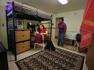 Allison Henry, a University of Oklahoma junior from Norman, and Harriet Orleans, an OU senior from Tulsa, check out a model suite in Walker Tower at OU. Photo by Steve Sisney, The Oklahoman ORG XMIT: KOD STEVE SISNEY - THE OKLAHOMAN
