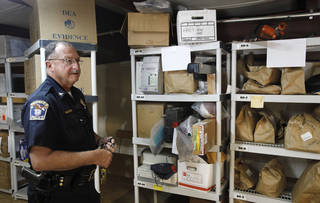Choctaw Police Chief Conny Clay demonstrates how his department's new property and evidence room will be organized on Thursday, July 26, 2012. Photo by Jim Beckel, The Oklahoman. Jim Beckel - THE OKLAHOMAN