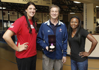 Coach Bill Hamiter and USA women's sitting volleyball team members Katie Holloway, left, and Kari Miller show their Paralympics silver medal at the University of Central Oklahoma in Edmond. Photo By Paul Hellstern, The Oklahoman