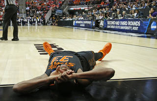 Oklahoma State's Marcus Smart (33) lays on the floor after a foul during a second round game of the NCAA men's college basketball tournament at Viejas Arena in San Diego, between Oklahoma State and Gonzaga Friday, March 21, 2014. Gonzaga won 85-77. Photo by Bryan Terry, The Oklahoman