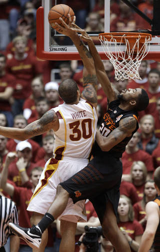 Iowa State forward Royce White (30) shoots over Oklahoma State forward Michael Cobbins, right, during the second half of an NCAA college basketball game, Wednesday, Jan. 18, 2012, in Ames, Iowa. Iowa State won 71-68. (AP Photo/Charlie Neibergall) ORG XMIT: IACN120