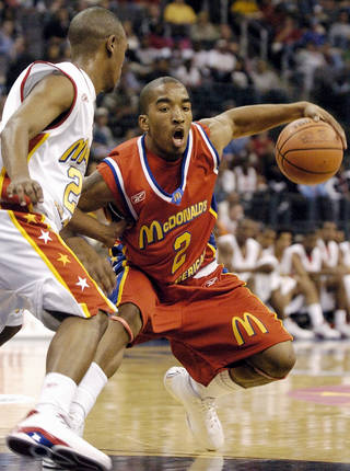 Oklahoma City, Okla. - March 31, 2004. McDonald's All American High School boys basketball game at the Ford Center. The East's J.R. Smith, right, of St. Benedict's Preparatory School in Newark, N.J., drives past the West's Daniel Gibson, of Jesse H. Jones High School in Houston, Texas. Smith led all scorers with 25 points. Staff photo by Nate Billings.