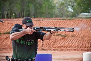 Jesse Tischauser of Edmond fires a shotgun in a 3-gun match, a competition which requires speed and proficiency with pistols, rifles and shotguns. PHOTO PROVIDED