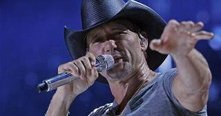 Tim McGraw performs during the CMA Fest at LP Field on Thursday], June 5, 2014, in Nashville, Tenn. (Photo by [Wade Payne/Invision/AP)
