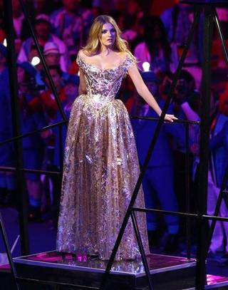 """British model Lily Donaldson poses during a performance set to David Bowie's """"Fashion,"""" during the Closing Ceremony at the 2012 Summer Olympics, Sunday, Aug. 12, 2012, in London. (AP Photo/Sergei Grits)"""