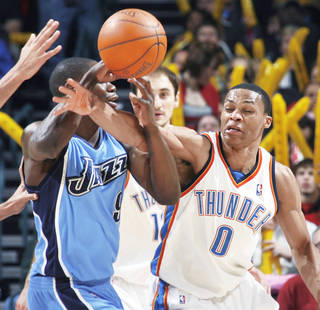 Thunder guard Russell Westbrook, right, tries to knock the ball away from Utah's Ronnie Brewer during Oklahoma City's 87-86 win Thursday. PHOTO BY NATE BILLINGS, THE OKLAHOMAN
