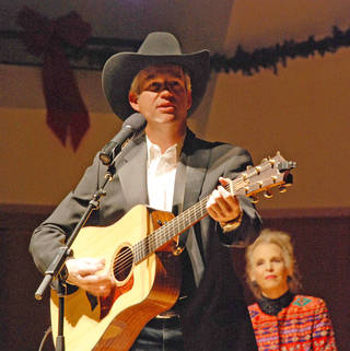 Tim Sullivan performs at last year's Sullivan Family Concert. His mother, Elizabeth, is in the background. PHOTO PROVIDED