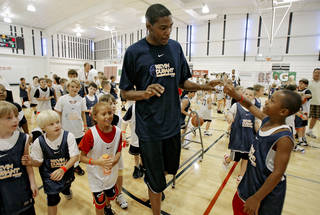 Kevin Durant, of the Oklahoma City Thunder, gives out high fives to camp participants during Durant's basketball camp at Heritage Hall on Tuesday, June 30, 2009, in Oklahoma City, Okla. Photo by Chris Landsberger, The Oklahoman ORG XMIT: KOD