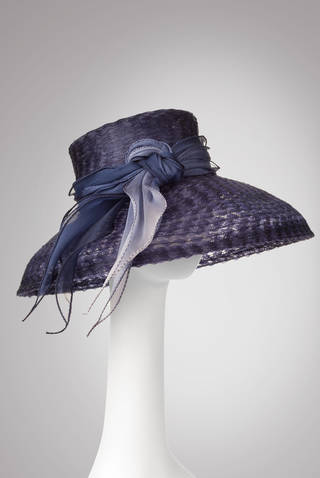 This hat is an example of the millinery fashions of Marla Cook. She and Lydia Sullivan-Benham will present a hat trimming workshop from 1 to 4 p.m. Feb. 23 at JRB Art at the Elms, 2810 N Walker. Photo provided.
