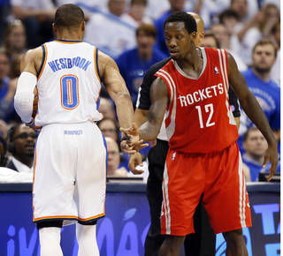 Oklahoma City's Russell Westbrook (0) brushes away the hand of Houston's Patrick Beverley (12) after Westbrook got up from being knocked to the floor as Beverly defended him during Game 2 in the first round of the NBA playoffs between the Oklahoma City Thunder and the Houston Rockets at Chesapeake Energy Arena in Oklahoma City, Wednesday, April 24, 2013. Photo by Nate Billings, The Oklahoman