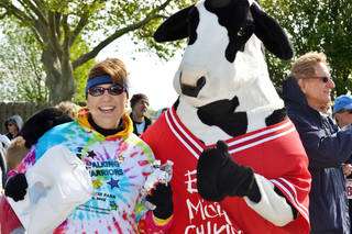 Melinda Parsons poses after a race with the Chick-fil-A Cow. Melinda is a volunteer for the Parkinson Foundation, which is planning a May 4 fundraising run. PHOTO PROVIDED BY PARKINSON FOUNDATION OF OKLAHOMA PROVIDED