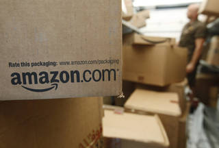 This Oct. 18, 2010, file photo shows an Amazon.com package on a UPS truck in Palo Alto, Calif. Amazon sold $40.8 billion worth of goods in North America in 2013. That's 17 percent of all e-commerce, according to Anne Zybowski, vice president of retail insights at research firm Kantar Retail. AP Photo Paul Sakuma -