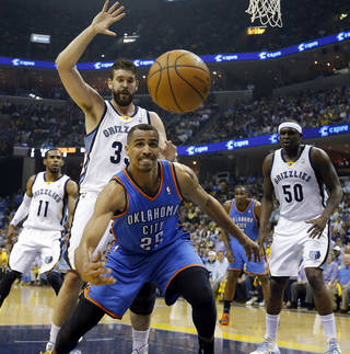 The ball goes out of bounds in front of Oklahoma City's Thabo Sefolosha (25) along with Memphis' Marc Gasol (33), Zach Randolph (50) and Mike Conley (11) during Game 4 in the first round of the NBA playoffs between the Oklahoma City Thunder and the Memphis Grizzlies at FedExForum in Memphis, Tenn., Saturday, April 26, 2014. Photo by Bryan Terry, The Oklahoman