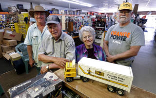E.J. and Nancy Crow pose with their sons in their OTASCO store on Tuesday, July 8, 2014 in Marlow, Okla. Today their son Mike, right, runs the operation and retired son Ron, left, helps out. Photo by Steve Sisney, The Oklahoman