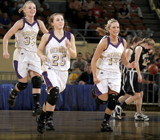 Okarche's Kristen Meyer, left, Brooke Edwards, and Macy Kunneman celebrate as Seiling's Aubrey Colvard walks of the court during the Class A girls basketball state tournament at the State Fair Arena in Oklahoma City, Friday, March 5, 2010. Photo by Bryan Terry, The Oklahoman