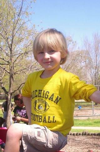 Cooper Barton. Oklahoma City Public Schools officials will review the district dress code policy after a kindergartner was asked to turn his University of Michigan T-shirt inside out. Kindergartner Cooper Barton, 5, turned his shirt inside out behind a tree on the playground after a teacher at Wilson Elementary School noticed he was breaking the district dress code policy. ORG XMIT: 1208241845122379