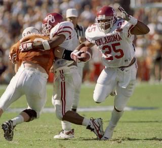 OU #25 James Allen looks for running room in 2nd qtr. during OU vs. Texas football game.