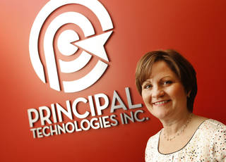 Pam Fountain-Wilks, president of Principal Technologies staffing company, poses in her company offices. Photo by Steve Gooch, The Oklahoman Steve Gooch