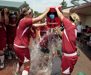 Head Coach Patty Gasso gets a cold shower from ther team as the University of Oklahoma Sooner Softball team defeats Arizona in game two of the NCAA Softball Norman Super Regional at Marita Hines field on Saturday, May 26, 2012, in Norman, Okla. Photo by Steve Sisney, The Oklahoman