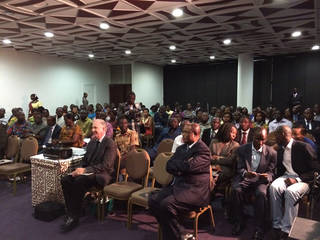 An audience of civic leaders in Abidjan congregates to hear Wes Lane speak about SALLT.Photo provided
