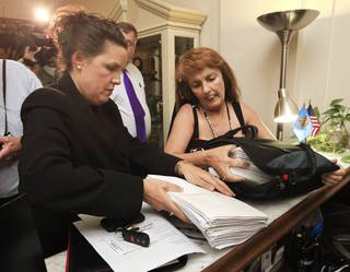 Cindy Jones and Karen Monahan unpack petitions in support of Jerome Earsland on the receptionists desk in the Governor's office at the Capitol in Oklahoma City Thursday, July 7, 2011. Photo by Paul B. Southerland, The Oklahoman
