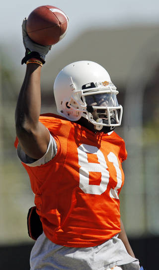 OSU's Justin Blackmon (81) holds up the ball after running a drill during spring football practice for the Oklahoma State Cowboys in Stillwater, Okla., Friday, April 1, 2011. Photo by Nate Billings, The Oklahoman