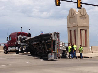 A tractor-trailer lost its payload Tuesday afternoon on a Pennsylvania Avenue bridge north of Interstate 40. Oklahoma City police received the call about noon and sent a wrecker to assist with the cleanup. It is unclear how the payload tipped over and onto the road, police said. Photo by Steve Gooch, The Oklahoman -