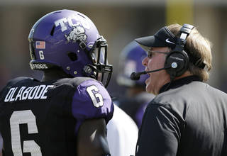 TCU head coach Gary Patterson, right, instructs safety Elisha Olabode (6) following a play against Kansas in the second half of an NCAA college football game, Saturday, Oct. 12, 2013, in Fort Worth, Texas. TCU won 27-176. (AP Photo/Tony Gutierrez) ORG XMIT: TXTG217