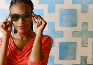 Kate Spade gold sunglasses with gold mirrored lens and T Tahari draped-front top from Dillard's, Penn Square Mall. Model is Albreuna. Makeup by Lilly Stone, Sooo Lilly Cosmetics. Photo by Chris Landsberger, The Oklahoman. CHRIS LANDSBERGER