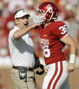 OU coach Bob Stoops congratulates Tress Way after a punt during the first half of the Bedlam college football game between the University of Oklahoma Sooners (OU) and the Oklahoma State University Cowboys (OSU) at the Gaylord Family-Oklahoma Memorial Stadium on Saturday, Nov. 28, 2009, in Norman, Okla. Photo by Bryan Terry, The Oklahoman