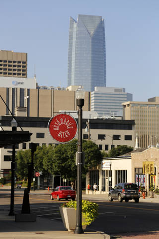 An Automobile Alley sign looking south toward downtown with the Devon Energy Tower in the background is seen. Photo by Doug Hoke, The Oklahoman DOUG HOKE - THE OKLAHOMAN