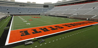 New football turf being installed inside OSU's Boone Pickens Stadium in Stillwater, Okla., Friday, June 6, 2014. Photo by Nate Billings, The Oklahoman