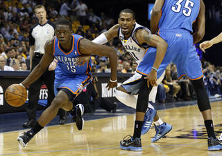 MEMPHIS GRIZZLIES: Oklahoma City's Reggie Jackson (15) drives past Memphis' Mike Conley (11) as Oklahoma City's Kevin Durant (35) sets a screen during Game 3 in the second round of the NBA basketball playoffs between the Oklahoma City Thunder and Memphis Grizzles at the FedExForum in Memphis, Tenn., Saturday, May 11, 2013. Photo by Nate Billings, The Oklahoman