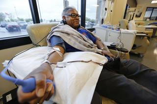 Joseph Eddens donates platelets at the Oklahoma Blood Institute in Oklahoma City. Eddens said he donates platelets on a regular basis because he wants to help people who need them. Steve Gooch - The Oklahoman