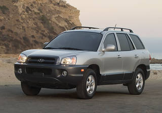 A 2005 Hyundai Santa Fe is shown. Hyundai is recalling more than 419,000 cars and SUVs to fix suspension, brake and oil leak problems. AP Photo -