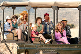 "Drew Barrymore, second from left, Adam Sandler, center, and Kevin Nealon, right, in a scene from the motion picture ""Blended."" David Bloomer, Warner Bros. Pictures David Bloomer"