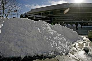 People walk past a pile of snow on the way to the Oklahoma City Arena on Wednesday, Feb. 2, 2011. Photo by Bryan Terry